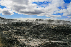 Black lava and steam Royalty Free Stock Image
