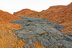 Black Lava Flow on Red Volcanic Ash Stock Images