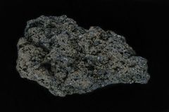 Black lava rock from Batur volcano isolated on black background royalty free stock photos