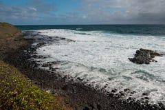 Black Lava Rock Beach in Kauai Royalty Free Stock Photo