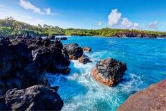 Black lava rock beach, road to Hana, Maui. Royalty Free Stock Photos