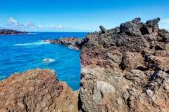 Black lava rock beach, road to Hana, Maui. Stock Images