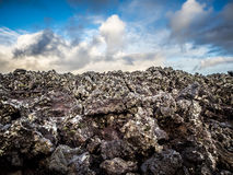 Black Lava Rock with Dramatic Sky Stock Photo