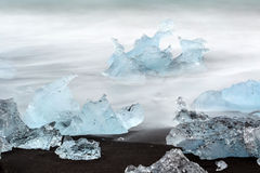 Black lava sand with icebergs from glaciers Stock Photo
