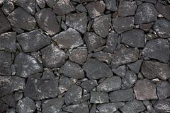 Black lava stone volcanic masonry wall Royalty Free Stock Image