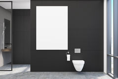 Black lavatory, poster. Black lavatory interior with a vertical poster, a shower with a glass wall and a loft window. 3d rendering mock up Stock Photo
