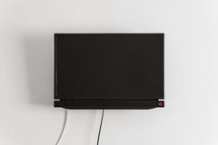 Black LCD or LED tv screen hanging on a wall Royalty Free Stock Photo