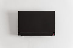 Black LCD or LED tv screen hanging on a wall Royalty Free Stock Images
