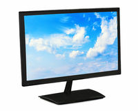 Black Lcd Monitor With Blue Sky Isolated On White Background. Stock Photo