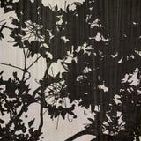 Black leaf print on pale background. Black leaf print on pale textured background stock photo