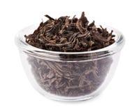 Black leaf tea heap in transparent glass bowl Stock Photos