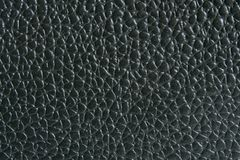 Black leather. Natural black leather background closeup Stock Photos