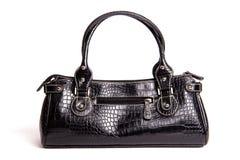 Black leather. Fake crocodile leather bag isolated on white Royalty Free Stock Image