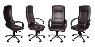 Black leather armchairs. Some black leather armchairs in different foreshortenings are isolated royalty free stock photos