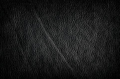 Black leather background. Black artificial leather background with vignette royalty free stock photos