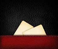 Black leather background with retro cardboards. Stock Images
