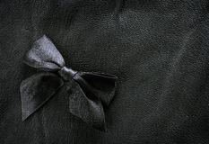 Black leather background with ribbon Stock Photo