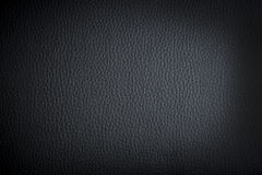 Black leather background. Or texture with dark vignette borders Stock Photography