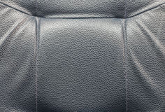 Black leather background texture. Black leather background with seam, rough texture Royalty Free Stock Images
