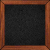 Black leather background in wooden brown frame. Or grey grain texture Royalty Free Stock Image