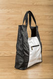 Black leather bag and gray Women Royalty Free Stock Photo