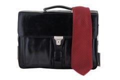 Black leather bag with necktie Stock Photos