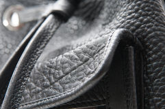 Black leather bag. Stitching detail from a fashionable bag Stock Images