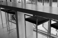 Black leather bar stool beside the window Royalty Free Stock Images