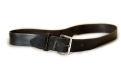 Black leather belt. An old worn black leather belt with buckle royalty free stock photo