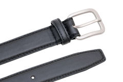 Black leather belt. Men`s black leather belt with classic metallic buckle Royalty Free Stock Images