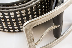 Black leather belt with nails closeup Royalty Free Stock Photos
