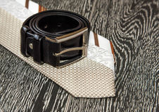 Black leather belt and ties Stock Images
