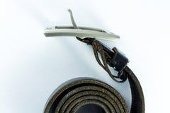Black leather belt on white background Royalty Free Stock Photography