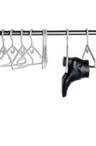 Black leather boot hanging a closet pole. Black leather boot hanging from a hanger on a closet pole royalty free stock images