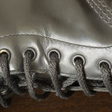 Black leather boot with laces. Black leather dirty boot with laces, close-up stock photos