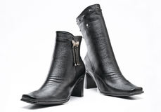Black leather boots. A pair of high heel leather boots Royalty Free Stock Photo