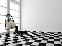 The black leather boots and a bag in the interior Royalty Free Stock Photo