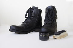 Black Leather Boots, brush and cream. Stock Photos