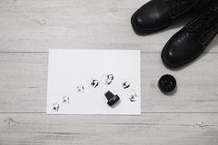 Black leather boots with shoe maintenance set on a wooden background Stock Photos