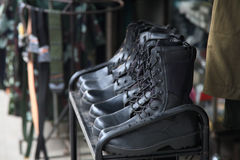 Black leather boots and soldier gears Stock Photo