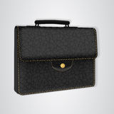 Black leather briefcase on the button. Royalty Free Stock Image