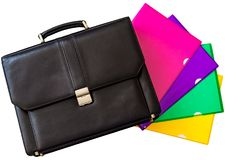 Black leather briefcase and colorful folding covers or holders f Stock Photo