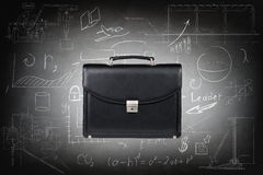 Black leather briefcase over gray wall Stock Images