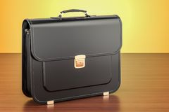 Black leather briefcase on the wooden table. 3D rendering. Black leather briefcase on the wooden table. 3D Stock Images