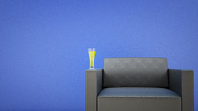 Black leather chair. And a glass of beer Stock Images