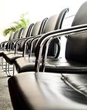 Black leather chairs. All the chairs in the lounge are upholstered in black leather Royalty Free Stock Photography