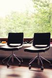 Black leather chairs in office Stock Image