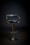 Black leather and chrome barbershop chair. Stock Photo