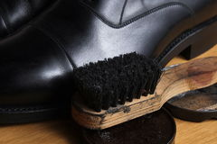 Black leather classic formal shoes with polishing cream and brush Royalty Free Stock Photography