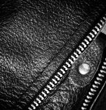 Black leather clothing with a zipper. macro photo Royalty Free Stock Photography